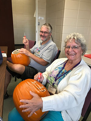 two-students-with-their-pumpkins