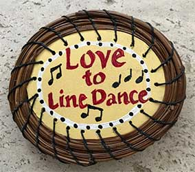 Line Dance magnet with pine needles